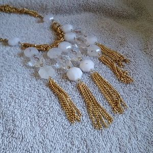 Gold and white necklace with clasp